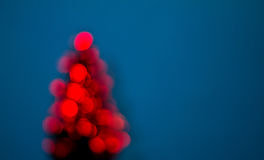 Christmas tree. Blurred christmas tree lights isolated on blue background Stock Photos