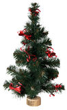 Christmas tree. Small artificial green Christmas tree on white Royalty Free Stock Photos