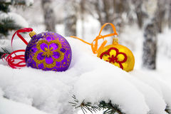 Christmas-tree. Two color christmas baubles sitting in a bed of snow Royalty Free Stock Photography