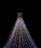 Christmas tree. The christmas tree from light on black background Royalty Free Stock Photo