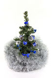 Christmas Tree. Decorated with blue , silver ornaments and tinsel, isolated on a white background Stock Photography