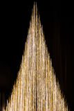 Christmas Tree Abstract of Gold and White Light Streaks. Gold and white vertical streaks of light in shape of Christmas Tree Royalty Free Stock Photography