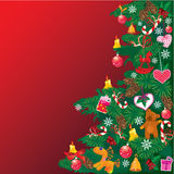 Christmas tree with accessories on red Royalty Free Stock Photo