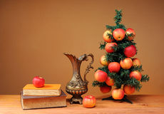 Christmas tree adorned with with apples and books Stock Image