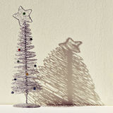 Christmas tree against a white wall Stock Image