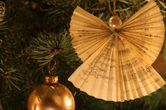 Christmas Tree Angel Decoration. Made by folding a prayer book's sheet of paper royalty free stock photos