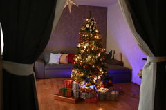 Christmas tree. In the apartment stock photo