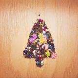 Christmas tree arrange from shiny sequins on wooden background.. Royalty Free Stock Image
