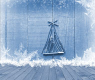 Christmas tree arranged from sticks on empty wooden deck table on sparkly blue background. Ready for product display montage.  stock images