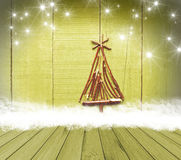 Christmas tree arranged from sticks on empty wooden deck table on sparkly green background. Ready for product display montage Royalty Free Stock Photography