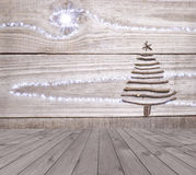 Christmas tree arranged from sticks on empty wooden deck table on sparkly grey background. Ready for product display montage Stock Photography