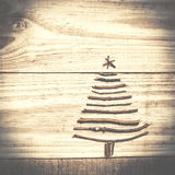 Christmas tree arranged from sticks on wooden sparkly grey backg Royalty Free Stock Photos