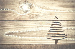 Christmas tree arranged from sticks on wooden sparkly grey backg Stock Photography