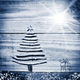 Christmas tree arranged from sticks on wooden sparkly grey backg Royalty Free Stock Photo