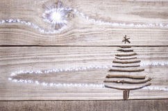 Christmas tree arranged from sticks on wooden sparkly grey background Royalty Free Stock Photos