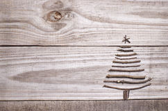 Christmas tree. Arranged from twigs on grey wooden background stock photo