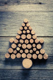 Christmas tree arranged with wine cork. On old wooden table Royalty Free Stock Photography