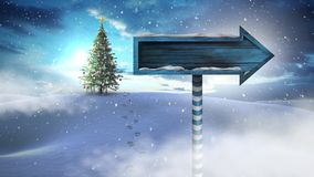 Christmas tree and arrow sign in Winter landscape stock footage