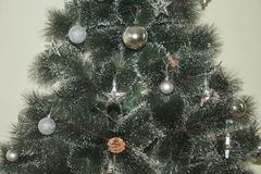 Christmas tree artificial with Christmas royalty free stock image