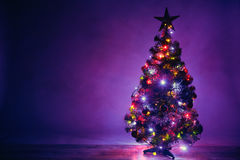 Christmas tree artistic silhouette with lights garland Stock Photos