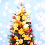 Christmas tree background with blurred, sparking, glowing. Happy New Year and Xmas theme. Christmas tree background with blurred, sparking, glowing. Happy New Stock Image