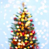 Christmas tree background with blurred, sparking, glowing. Happy New Year and Xmas theme. Christmas tree background with blurred, sparking, glowing. Happy New Stock Photo