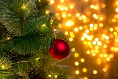 Christmas tree on the background of blurry lights of Christmas garland. stock image
