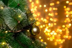Christmas tree on the background of blurry lights of Christmas garland. royalty free stock photography