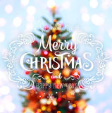 Christmas tree background and Christmas decorations with blurred, sparking, glowing and text Merry Christmas and Happy New Year. X. Mas theme Royalty Free Stock Images