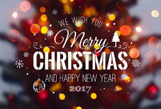 Christmas tree background and Christmas decorations with blurred, sparking, glowing and text Merry Christmas and Happy New Year Royalty Free Stock Photography