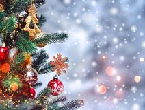 Christmas tree background and Christmas decorations with snow, blurred, sparking, glowing. royalty free stock photography