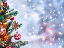 Christmas tree background and Christmas decorations with snow, blurred, sparking, glowing. royalty free stock photo