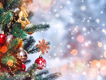 Christmas tree background and Christmas decorations with snow, blurred, sparking, glowing. Happy New Year and Xmas Stock Images