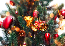 Christmas tree background and Christmas decorations with snow, blurred, sparking, glowing. Happy New Year and Xmas Royalty Free Stock Image