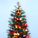 Christmas tree background and Christmas decorations with snow, blurred, sparking, glowing. Happy New Year and Xmas Royalty Free Stock Photos