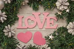 Christmas tree background with copy space and word love from wood. Royalty Free Stock Image