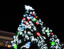 Christmas tree background with defocused lights Royalty Free Stock Photography