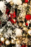 Christmas tree background with different hanging toys. Christmas snowy tree background with different hanging toys and garland of lights royalty free stock photo