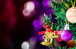 Christmas tree background. Gold Christmas background of de-focused lights with decorated tree Stock Images