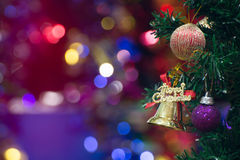 Christmas tree background. Gold Christmas background of de-focused lights with decorated treenn Stock Photos