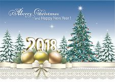2018 Christmas tree on a background of nature. Festive Christmas tree with balls and decorative bow on the sky background Stock Images