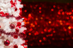 Christmas Tree Background, White Xmas Tree Red Defocused Lights Royalty Free Stock Photo