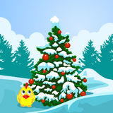 Christmas tree on the background of a winter landscape. New Year card. Christmas tree on the background of a winter landscape. Chicken in the snow under the Stock Photography