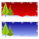 Christmas Tree Backgrounds. Your choice of two colorful Christmas tree and snowflake backgrounds in red and blue Royalty Free Stock Photo