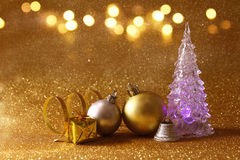 Christmas tree and ball decorations on glitter background Stock Photos