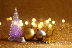 Christmas tree and ball decorations on glitter background Stock Photography