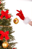 Christmas tree, ball and hand of christmas girl. Royalty Free Stock Image