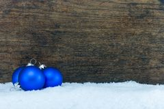 Christmas tree ball and wooden background stock photos