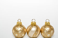 Christmas tree balls. Three golden christmas tree balls Stock Photography