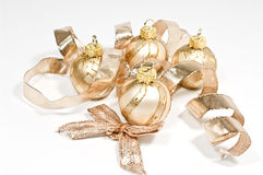 Christmas tree balls. Four golden christmas tree balls and Stock Photography